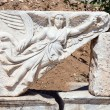 Stone carving of the goddess Nike at the ruins of ancient Ephesus, Turkey — Stock Photo #28447871