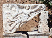Stone carving of the goddess Nike at the ruins of ancient Ephesus, Turkey — Stock Photo