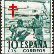 SPAIN - CIRCA 1951: A stamp printed in Spain from the Anti-tubercul osis Fund issue shows children on beach, circa 1951.  — Stock Photo