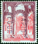 "SPAIN - CIRCA 1964: A stamp printed in Spain from the ""Tourist"" issue shows the interior of La Mezquita, Cordova, circa 1964. — Stock Photo"