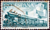 "SPAIN - CIRCA 1958: A stamp printed in Spain from the ""17th international railway congress, Madrid"" issue shows Class 242F steam locomotive and Castillo de La Mota, circa 1958. — Stock Photo"