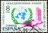 SPAIN - CIRCA 1970: A stamp printed in Spain issued for the 25th anniversary of United Nations shows U.N. Emblem and New York Headquarters, circa 1970. — Stok fotoğraf