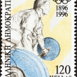 "Stock Photo: GREECE - CIRC1996: stamp printed in Greece from ""Modern Olympic games centenary"" issue shows weigh tlifter, circ1996."