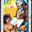 SPAIN - CIRCA 1969: A stamp printed in Spain issued for the bicentenary of San Diego, California shows Franciscan Friar and child, circa 1969. — Stock Photo #30132365