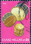 "GREECE - CIRCA 1975: A stamp printed in Greece from the ""traditional musical instruments"" issue shows Tambourine Drums, circa 1975. — Stock Photo"