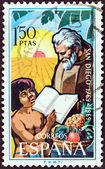 SPAIN - CIRCA 1969: A stamp printed in Spain issued for the bicentenary of San Diego, California shows Franciscan Friar and child, circa 1969. — Stock Photo