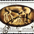"Foto de Stock  : GREECE - CIRC1976: stamp printed in Greece from ""Ancient Sealing-stones"" issue shows Cow feeding calf, onyx, 15th century BC, circ1976."