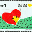 "图库照片: ISRAEL - CIRC1990: stamp printed in Israel from ""Greetings Stamps"" issue shows Patched Heart (With Love), circ1990."