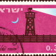 "Stock Photo: ISRAEL - CIRC1963: stamp printed in Israel from ""25th anniversary of Stockade and Tower villages"" issue shows Completed stockade at night, circ1963."