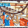 "NIGERIA - CIRCA 1986: A stamp printed in Nigeria from the ""Nigerian life"" issue shows a modern post office, circa 1986. — Stock Photo"