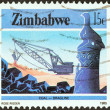 "ZIMBABWE - CIRC1985: stamp printed in Zimbabwe from ""National Infrastructure"" issue shows Dragline coal mining, circ1985. — Stock Photo #31273419"