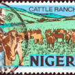 NIGERIA - CIRCA 1973: A stamp printed in Nigeria shows Cattle ranching, circa 1973. — Stock Photo