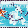 "TURKEY - CIRCA 1954: A stamp printed in Turkey from the ""child welfare"" issue shows a nurse with two children, circa 1954. — 图库照片"