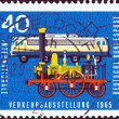 GERMANY - CIRCA 1965: A stamp printed in Germany from the International Transport Exhibition, Munich issue shows Locomotive Adler (1835) and Class E.10.12 electric locomotive (1960s), circa 1965.  — Stock Photo