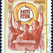 "USSR - CIRCA 1974: A stamp printed in USSR from the ""Scientific and Technical Youth Work Review"" issue shows Young Workers and Emblem, circa 1974. — Stock Photo #31273677"