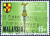 """MALAYSIA - CIRCA 1967: A stamp printed in Malaysia from the """"Centenary of Sarawak Council"""" issue shows Mace and Shield, circa 1967. — Stock Photo"""
