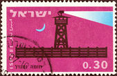 "ISRAEL - CIRCA 1963: A stamp printed in Israel from the ""25th anniversary of the Stockade and Tower villages"" issue shows Completed stockade at night, circa 1963. — Stock Photo"