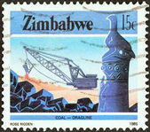 "ZIMBABWE - CIRCA 1985: A stamp printed in Zimbabwe from the ""National Infrastructure"" issue shows Dragline coal mining, circa 1985. — Stock Photo"