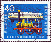 "GERMANY - CIRCA 1965: A stamp printed in Germany from the ""International Transport Exhibition, Munich"" issue shows Locomotive Adler (1835) and Class E.10.12 electric locomotive (1960s), circa 1965. — Stock Photo"