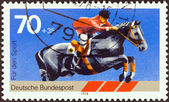 "GERMANY - CIRCA 1978: A stamp printed in Germany from the ""Sport Promotion Fund"" issue shows show jumping, circa 1978. — Stock Photo"