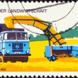"GERMAN DEMOCRATIC REPUBLIC - CIRCA 1977: A stamp printed in Germany from the ""Modern Agricultural Techniques"" issue shows High pressure harvester, circa 1977. — Stock Photo"