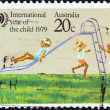 "图库照片: AUSTRALI- CIRC1979: stamp printed in Australifrom ""International Year of Child"" issue shows Children playing on Slide, circ1979."