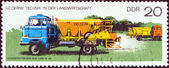"GERMAN DEMOCRATIC REPUBLIC - CIRCA 1977: A stamp printed in Germany from the ""Modern Agricultural Techniques"" issue shows Fertilizer spreader on truck, circa 1977. — Stock Photo"