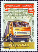 USSR - CIRCA 1974: A stamp printed in USSR issued for the 57th anniversary of October Revolution shows Kamaz truck, circa 1974. — Stock Photo