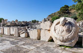 Ancient ruins of Eleusis, bust of Roman Emperor Marcus Aurelius in foreground, Attica, Greece — Stock Photo
