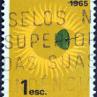 "Stock Photo: PORTUGAL - CIRC1964: stamp printed in Portugal from ""International Quiet Sun Years"" issue shows Sun and Globe, circ1964."