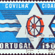 PORTUGAL - CIRCA 1970: A stamp printed in Portugal issued for the Centenary of City of Covilha shows Star and wheel from Covilha coat of arms, circa 1970. — Stock Photo