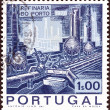 Stock Photo: PORTUGAL - CIRC1970: stamp printed in Portugal issued for Inauguration of Porto Oil Refinery shows Distillation Plant and Pipelines, circ1970.