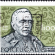PORTUGAL - CIRCA 1969: A stamp printed in Portugal issued for his 100th birth anniversary shows Marshal Carmona and oak leaves, circa 1969. — Stock Photo