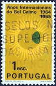 "PORTUGAL - CIRCA 1964: A stamp printed in Portugal from the ""International Quiet Sun Years"" issue shows Sun and Globe, circa 1964. — Stock Photo"