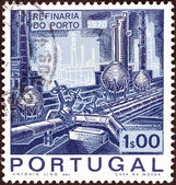 PORTUGAL - CIRCA 1970: A stamp printed in Portugal issued for the Inauguration of Porto Oil Refinery shows Distillation Plant and Pipelines, circa 1970. — Stock Photo