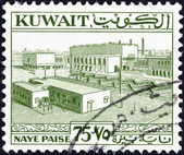 KUWAIT - CIRCA 1958: A stamp printed in Kuwait shows Main square, Kuwait, circa 1958. — Stock Photo