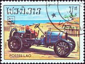 "LAOS - CIRCA 1984: A stamp printed in Laos from the ""19th UPU Congress, Hamburg. Classic sport and race cars"" issue shows Bugatti, circa 1984. — Stock Photo"