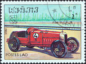 """LAOS - CIRCA 1984: A stamp printed in Laos from the """"19th UPU Congress, Hamburg. Classic sport and race cars"""" issue shows Fiat S 57 14B, circa 1984. — 图库照片"""