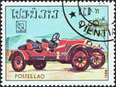 """LAOS - CIRCA 1984: A stamp printed in Laos from the """"19th UPU Congress, Hamburg. Classic sport and race cars"""" issue shows Nazzaro, circa 1984. — 图库照片"""