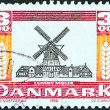 "DENMARK - CIRCA 1988: A stamp printed in Denmark from the ""Mills"" issue shows Lumby Windmill, circa 1988. — Stock Photo #33987409"