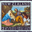 "NEW ZEALAND - CIRCA 1963: A stamp printed in New Zealand from the ""Christmas"" issue shows The Holy Family (by Titian), circa 1963. — Stock Photo #33987749"