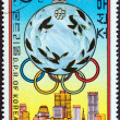 "NORTH KOREA - CIRCA 1976: A stamp printed in North Korea from the ""Olympic Medal Winners"" 1st issue shows Silver medal (cycling, Daniel Morelon), circa 1976. — Stock Photo"