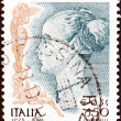 "ITALY - CIRCA 1998: A stamp printed in Italy from the ""Women in Art"" issue shows Profile of a Woman (Antonio del Pollaiuolo), circa 1998. — Stock Photo"
