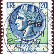 "ITALY - CIRCA 1968: A stamp printed in Italy from the ""Italy turreted (Syracuse)"" issue shows an Ancient coin of Syracuse, circa 1968. — Stock Photo #33988365"