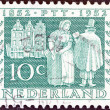 "Stock Photo: NETHERLANDS - CIRC1952: stamp printed in Netherlands from ""Netherlands Stamp Centenary and Centenary of Telegraph Service"" issue shows Postmdelivering letters, 1852, circ1952."