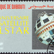 "DJIBOUTI - CIRCA 1987: A stamp printed in Djibouti from the ""Telecommunica tions Anniversaries"" issue shows Telstar Satellite (25th anniversary), circa 1987. — Stock Photo"