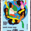 TOGO - CIRCA 1988: A stamp printed in Togo issued for the 40th anniversary of W.H.O.shows People with Candles, circa 1988. — Stock Photo