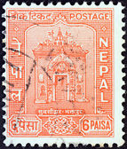 NEPAL - CIRCA 1959: A stamp printed in Nepal shows Gateway, Bhaktapur Palace, circa 1959. — Stock Photo
