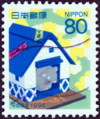 JAPAN - CIRCA 1995: A stamp printed in Japan shows mouse in a rice barn (Year of the Rat, 1996), circa 1995. — Stock Photo