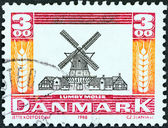 """DENMARK - CIRCA 1988: A stamp printed in Denmark from the """"Mills"""" issue shows Lumby Windmill, circa 1988. — Stock Photo"""